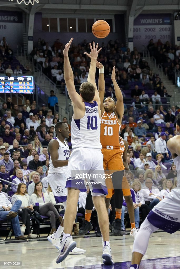 Texas Longhorns guard Eric Davis Jr. (10) shoots over TCU Horned Frogs forward Vladimir Brodziansky (10) during the game between the Texas Longhorns and TCU Horned Frogs on February 10, 2018 at Ed & Rae Schollmaier Arena in Fort Worth, TX.