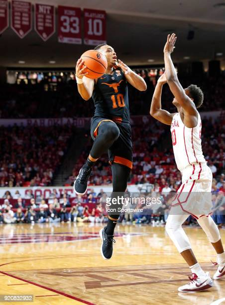 Texas Longhorns Guard Eric Davis working to get a shot as Oklahoma Sooners Guard Kameron McGusty defends during a college basketball game between the...