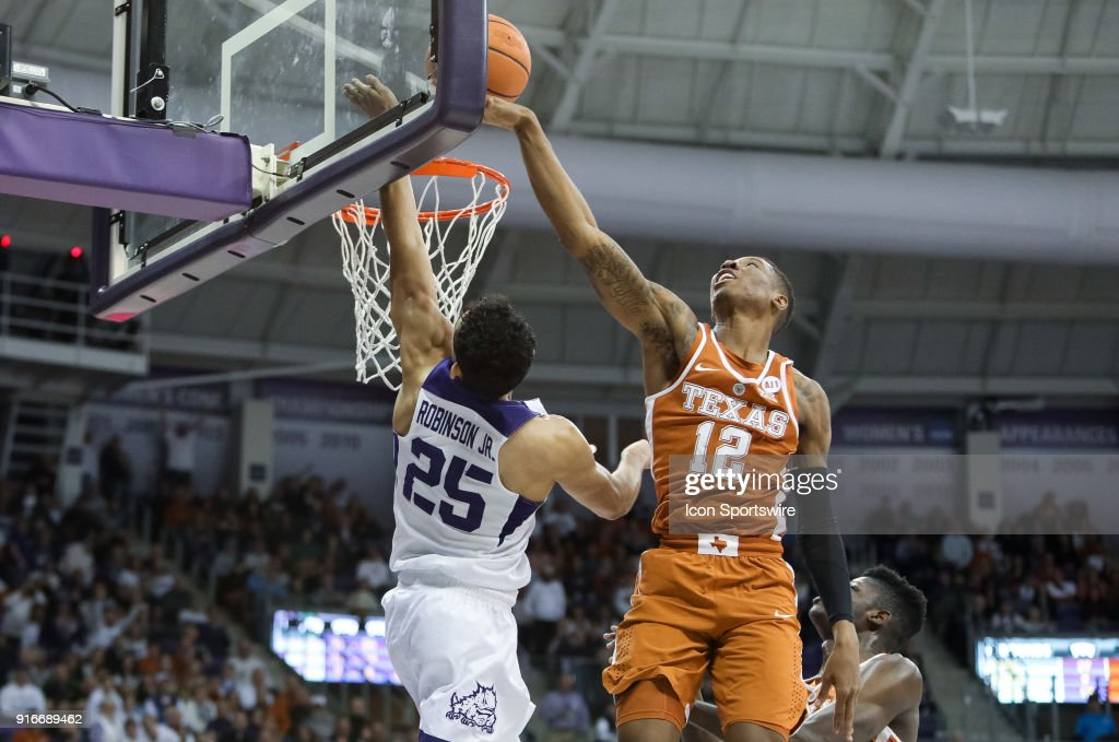 Texas Longhorns guard Kerwin Roach II (12) blocks the layup attempt from TCU Horned Frogs guard Alex Robinson (25) during the game between the Texas Longhorns and TCU Horned Frogs on February 10, 2018 at Ed & Rae Schollmaier Arena in Fort Worth, TX.