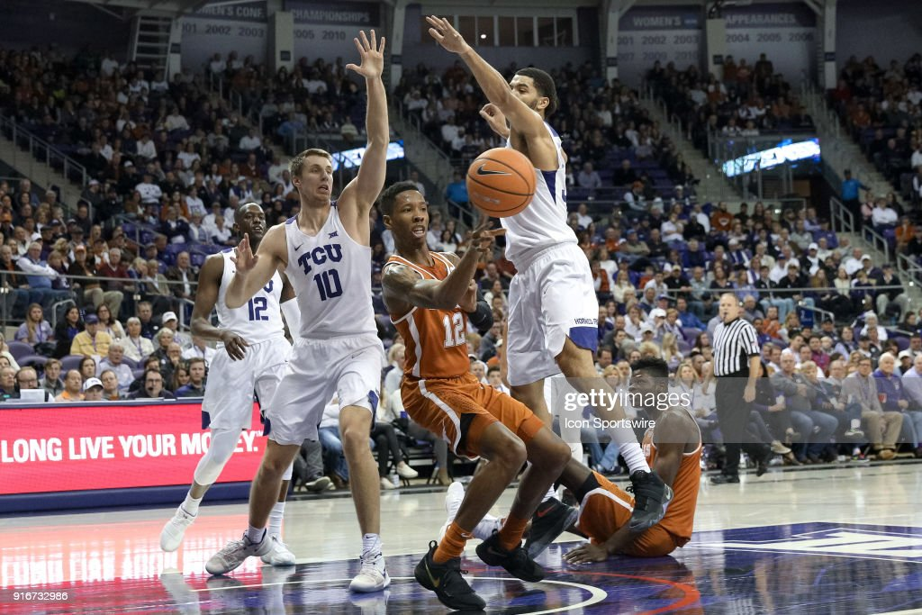 Texas Longhorns guard Kerwin Roach II (12) passes after being surrounded by TCU Horned Frogs forward Vladimir Brodziansky (10) and guard Kenrich Williams (34) in the lane during the game between the Texas Longhorns and TCU Horned Frogs on February 10, 2018 at Ed & Rae Schollmaier Arena in Fort Worth, TX.