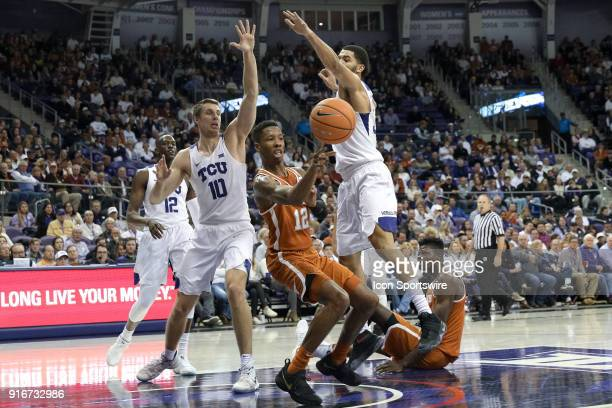 Texas Longhorns guard Kerwin Roach II passes after being surrounded by TCU Horned Frogs forward Vladimir Brodziansky and guard Kenrich Williams in...