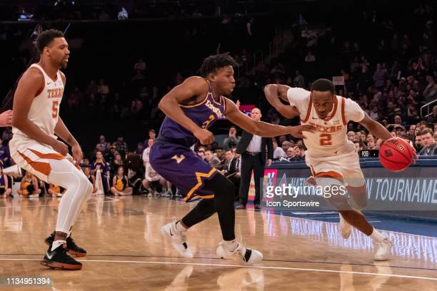 Texas Longhorns guard Matt Coleman III drives to the basket during the second half of the National Invitational Tournament college basketball...