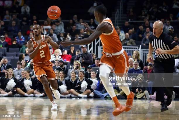 Texas Longhorns guard Matt Coleman III makes a fast-break pass to Texas Longhorns guard Andrew Jones during a college basketball game between Texas...
