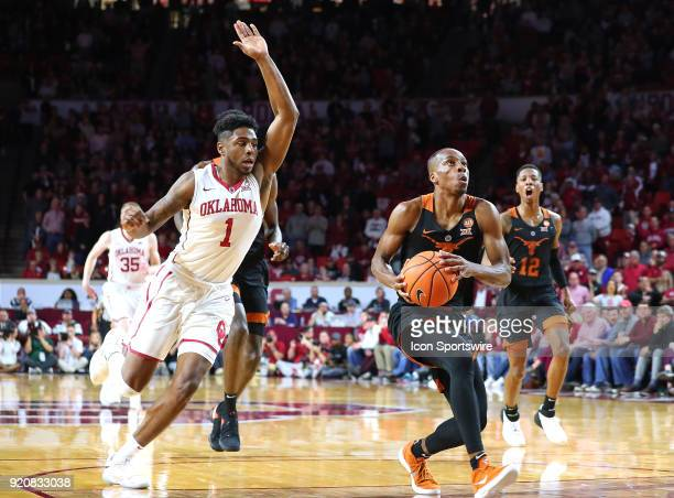 Texas Longhorns Guard Matt Coleman with the layup attempt as Oklahoma Sooners Guard Rashard Odomes gives chase during a college basketball game...