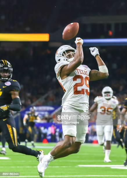 Texas Longhorns gunner Josh Thompson downs a Longhorns punt during the Texas Bowl game between the Texas Longhorns and Missouri Tigers on December 27...