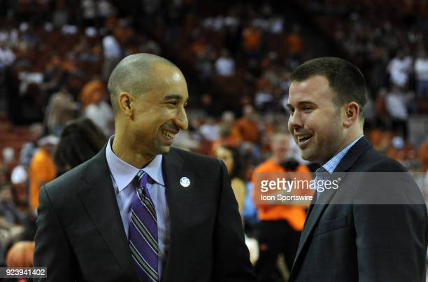 Texas Longhorns head coach Shaka Smart chats with Oklahoma State Cowboys assistant coach Keiton Page prior to start of a college basketball game...
