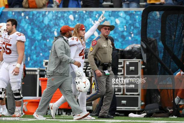 Texas Longhorns linebacker Breckyn Hager is escorted to the locker room after being ejected from the game for targeting during the second half of the...