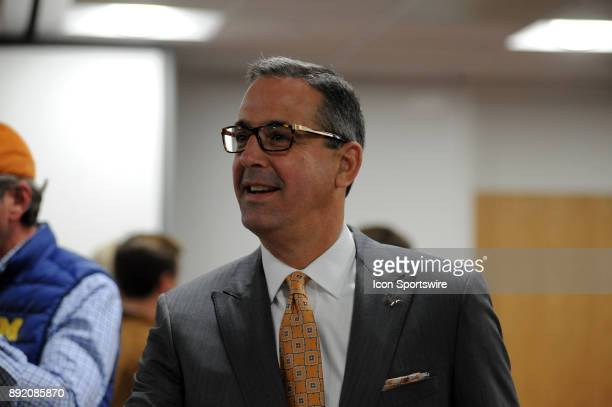 Texas Longhorns new athletic director Chris Del Conte chats with fans during the Texas Longhorns 59 52 loss to the Michigan Wolverines on December 12...