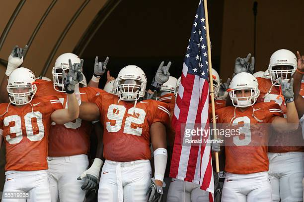 Texas Longhorns players Braden Johnson, Larry Dibbles and Karim Meijer stand in the tunnel before the game against the Louisiana-Lafayette Rajin'...