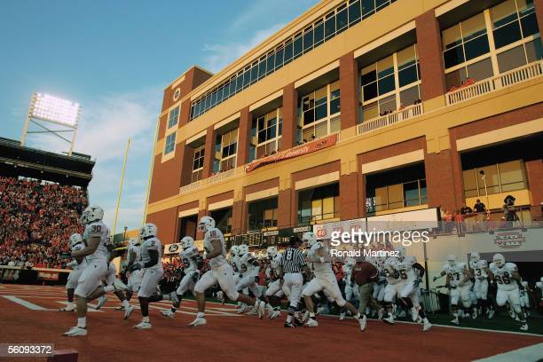 Texas Longhorns players run onto the field before the game against the Oklahoma State Cowboys on October 29 2005 at Boone Pickens Stadium in...