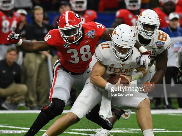 Texas Longhorns Quarterback Sam Ehlinger eludes the tackle of Georgia Bulldogs Linebacker Azeez Ojulari during the Allstate Sugar Bowl between the...