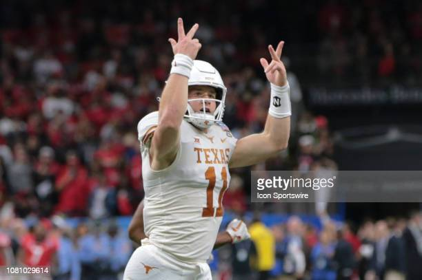 Texas Longhorns quarterback Sam Ehlinger hypes the crowd after scoring in the first half during the Allstate Sugar Bowl game between the Georgia...