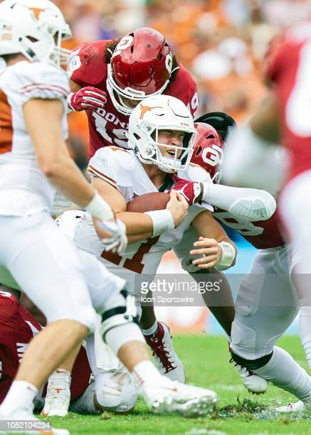 Texas Longhorns quarterback Sam Ehlinger is sacked by Oklahoma Sooners defensive back Kenneth Murray during the Red River Showdown between the...