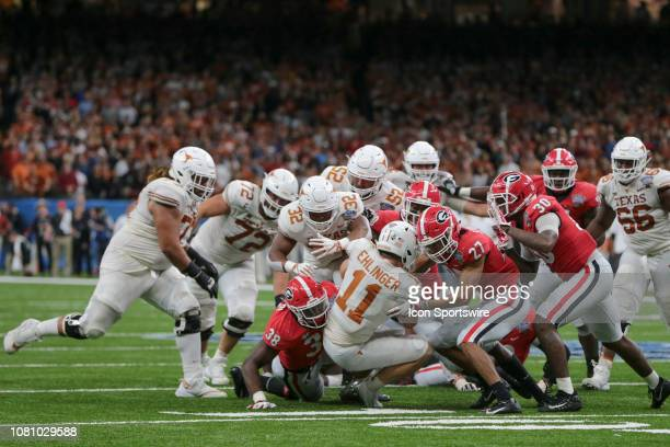 Texas Longhorns quarterback Sam Ehlinger keeps and is stopped short of the goal line during the Allstate Sugar Bowl game between the Georgia Bulldogs...