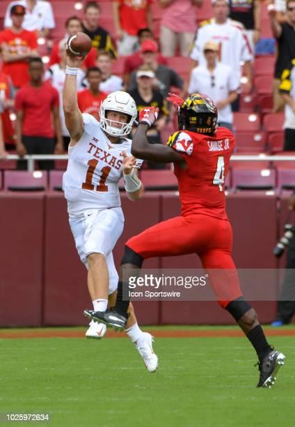 Texas Longhorns quarterback Sam Ehlinger passes in the first quarter under pressure from Maryland Terrapins defensive back Darnell Savage Jr on...