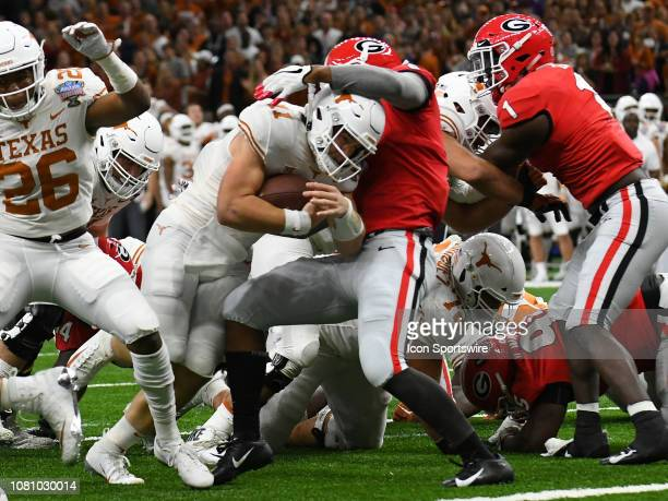 Texas Longhorns Quarterback Sam Ehlinger rushes for a touchdown during the Allstate Sugar Bowl between the Texas Longhorns and the Georgia Bulldogs...