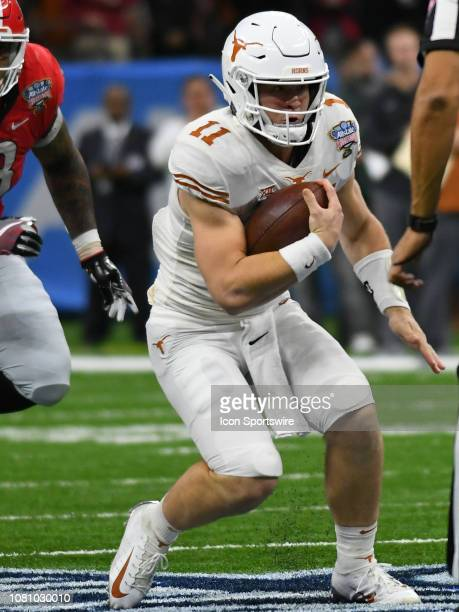 Texas Longhorns Quarterback Sam Ehlinger rushes the ball during the Allstate Sugar Bowl between the Texas Longhorns and the Georgia Bulldogs on...