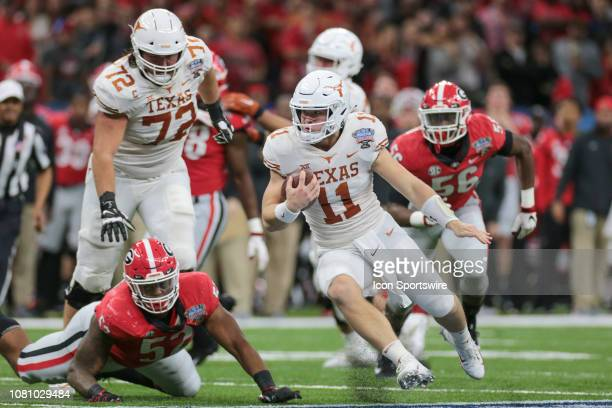 Texas Longhorns quarterback Sam Ehlinger scrambles for yardage during the Allstate Sugar Bowl game between the Georgia Bulldogs and the Texas...