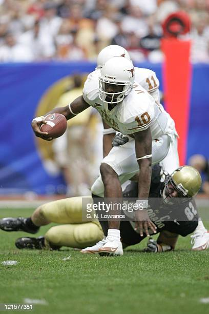 Texas Longhorns quarterback Vince Young attempts to elude defenders of the Colorado Buffalos in the Big 12 Championship at Reliant Stadium in...