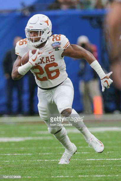Texas Longhorns running back Keaontay Ingram carries during the Allstate Sugar Bowl game between the Georgia Bulldogs and the Texas Longhorns on...