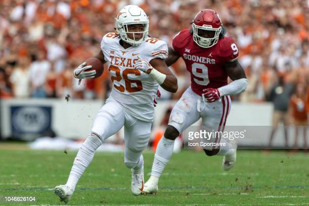Texas Longhorns running back Keaontay Ingram followed by Oklahoma Sooners linebacker Kenneth Murray during the Big 12 Conference Red River Rivalry...