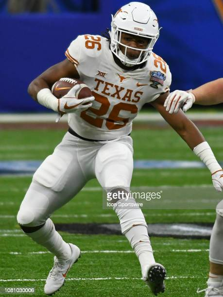 Texas Longhorns Running Back Keaontay Ingram rushes the ball during the Allstate Sugar Bowl between the Texas Longhorns and the Georgia Bulldogs on...