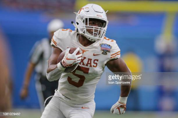Texas Longhorns running back Tre Watson breaks for long yardage during the Allstate Sugar Bowl game between the Georgia Bulldogs and the Texas...