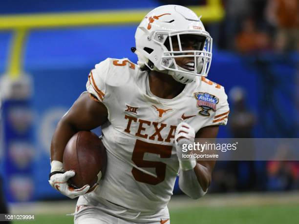 Texas Longhorns Running Back Tre Watson rushes the ball during the Allstate Sugar Bowl between the Texas Longhorns and the Georgia Bulldogs on...