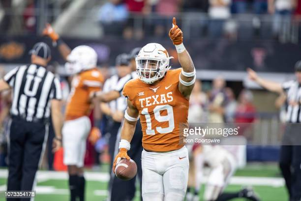 Texas Longhorns safety Brandon Jones celebrates a fumble recovery during the Big 12 Championship game between the Oklahoma Sooners and the Texas...