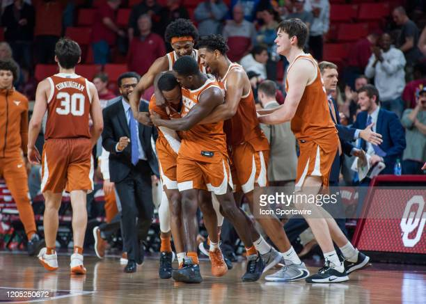 Texas Longhorns team celebrating after defeating the Oklahoma Sooners on March 3 at the Lloyd Noble Center in Norman OK
