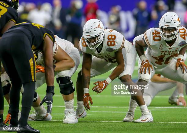 Texas Longhorns tight end Kendall Moore sets up a the line of scrimmage during the Texas Bowl game between the Texas Longhorns and Missouri Tigers on...