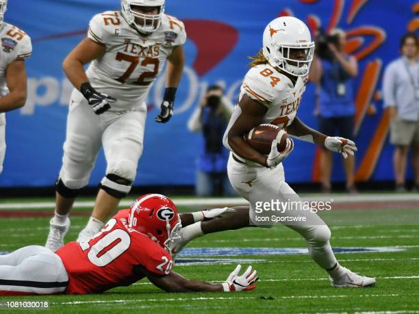 Texas Longhorns Wide Receiver Lil'Jordan Humphrey rushes past Georgia Bulldogs Defensive Back JR Reed during the Allstate Sugar Bowl between the...
