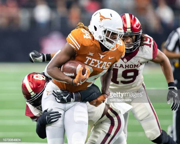 Texas Longhorns wide receiver Lil'Jordan Humphrey tries to break away from Oklahoma Sooners linebacker Kenneth Murray during the Big 12 Championship...