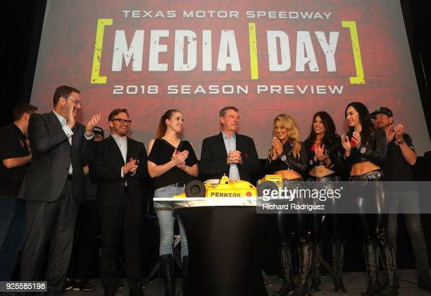 Texas Motor Spedway President Eddie Gossage Marcus Smith COO of Speedway Motorsports Erika Bridges baker of the Indy Car cake 3time Indy 500 winner...