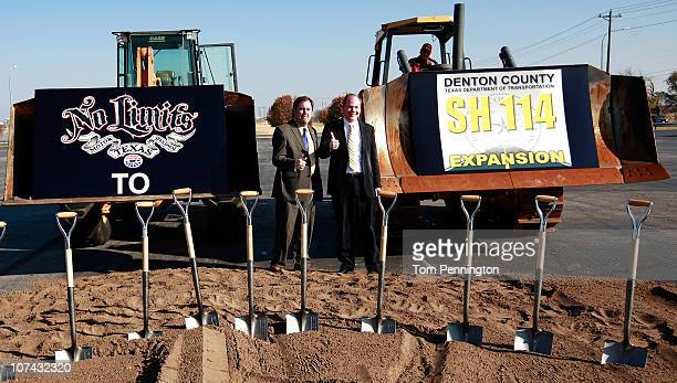 Texas Motor Speedway President Eddie Gossage and Denton County Commissioner Andy Eads give a thumbsup during a ground breaking ceremony for a new...