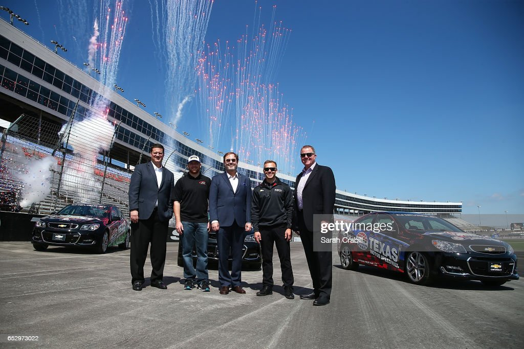 Texas Motor Speedway President, Eddie Gossage, Monster Energy NASCAR Cup Series driver for JTG Daugherty Racing, Chris Buescher, NASCAR Executive Vice President and Chief Racing Development Officer, Steve O'Donnell, Verizon IndyCar Series driver and owner for Ed Carpenter Racing, Ed Carpenter, IndyCar President of Competition and Operations, Jay Frye, pose for a photo during the Texas Motor Speedway Track Renovation Unveiling at Texas Motor Speedway on March 13, 2017 in Fort Worth, Texas.