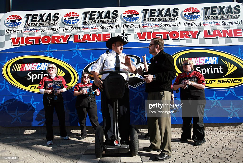 WORTH, TX JANUARY 14 - Texas Motor Speedway President Eddie Gossage presents actor and comedian Kevin James with a black cowboy hat in Victory Lane to promote the release of James' new movie, 'Paul Blart: Mall Cop' at Texas Motor Speedway in Fort Worth, Texas.