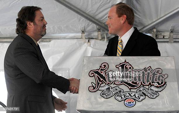 Texas Motor Speedway President Eddie Gossage shakes hands with Denton County Commissioner Andy Eads during a groundbreaking ceremony for a new State...