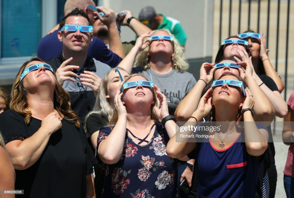 Texas Motor Speedway staff watch the solar eclipse at the Speedway on August 21, 2017 in Fort Worth, Texas. Millions of people have flocked to areas of the U.S. that are in the 'path of totality' in order to experience a total solar eclipse. During the event, the moon will pass in between the sun and the Earth, appearing to block the sun. Fort Worth residents will see about 75 percent of the sun blocked by the moon.