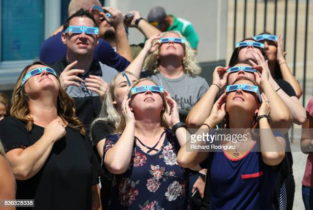 Texas Motor Speedway staff watch the solar eclipse at the Speedway on August 21 2017 in Fort Worth Texas Millions of people have flocked to areas of...