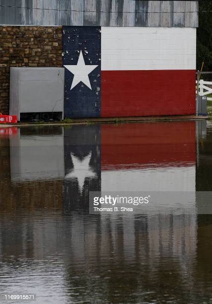 Texas mural is reflected in the flooded waters on highway 124 Gov on September 20 2019 in Beaumont Texas Gov Greg Abbott has declared much of...