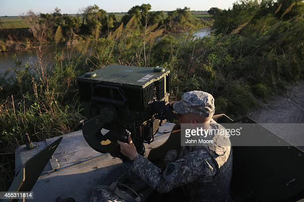 Texas National Guard soldier operates a LRAS3 surveillance system while monitoring the USMexico border on September 11 2014 in Havana Texas His unit...
