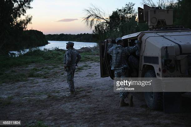 Texas National Guard soldiers monitor the USMexico border on September 11 2014 in Havana Texas The troops deployed along the Rio Grande are part of a...