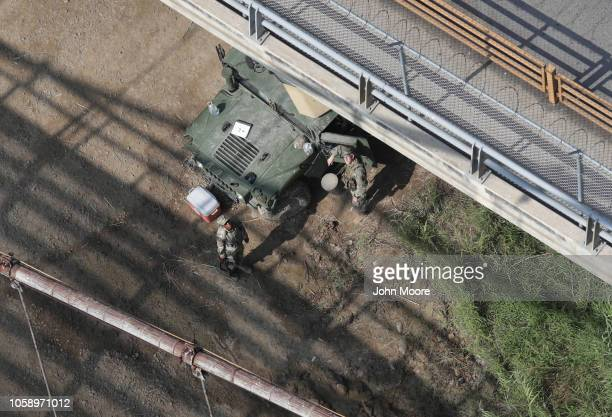 Texas National Guard troops look up from their post along the USMexico border on November 7 2018 in Roma Texas The guard troops have been stationed...