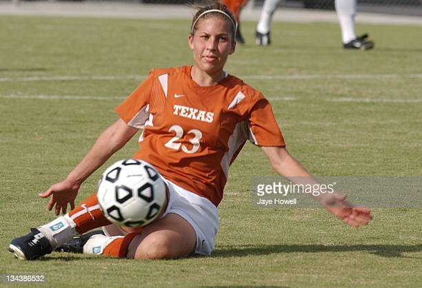 Texas Nicole Breger slides for the ball during the University of Texas vs. Texas A&M University soccer game in the Big 12 Womens Soccer Championships...