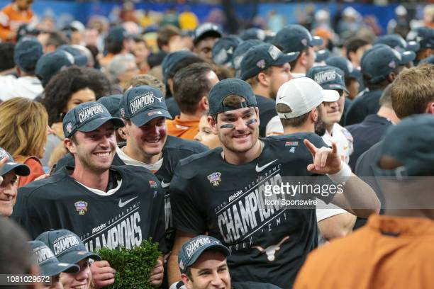 Texas players celebrate during the Allstate Sugar Bowl game between the Georgia Bulldogs and the Texas Longhorns on January 1 2019 at the...
