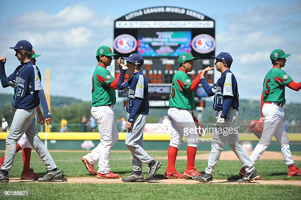 Texas players shake hands with Mexico after the consolation game at Volunteer Stadium on August 30 2009 in Williamsport Pennsylvania Mexico defeated...