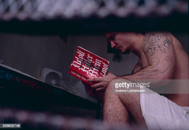 A Texas prisoner reads Adolf Hitler's autobiography Mein Kampf in his cell White prisoners are often subjected to a large variety of white suremacist...