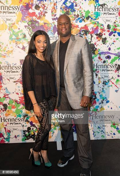 Texas quarterback and football legend Vince Young and wife Candice Johnson attend Hennessy VS Limited Edition by JonOne launch party at Native Hostel...