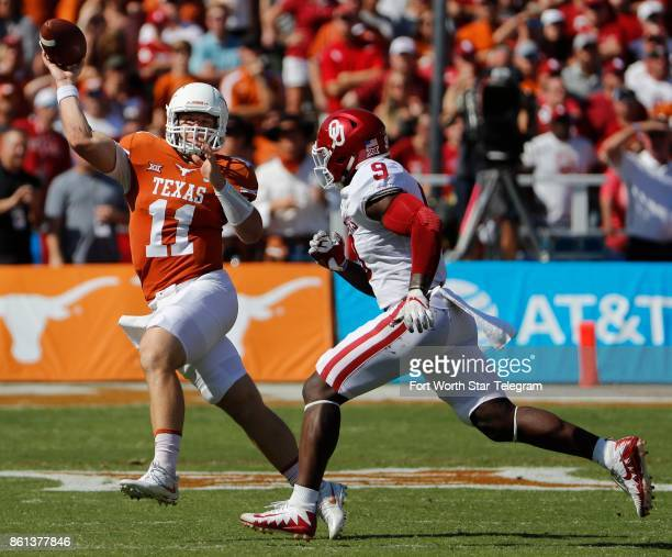 Texas quarterback Sam Ehlinger throws under pressure from Oklahoma linebacker Kenneth Murray in the first quarter during the annual Red River...